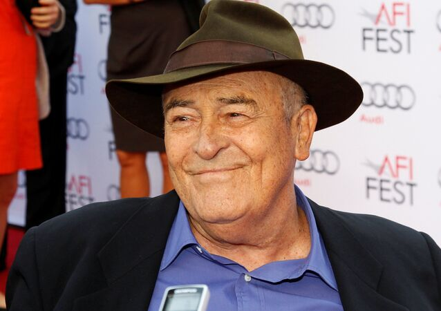 Italian director Bernardo Bertolucci is interviewed as he arrives for a gala screening of his film The Last Emperor in 3D at the AFI Fest 2013 in Hollywood, California, November 10, 2013