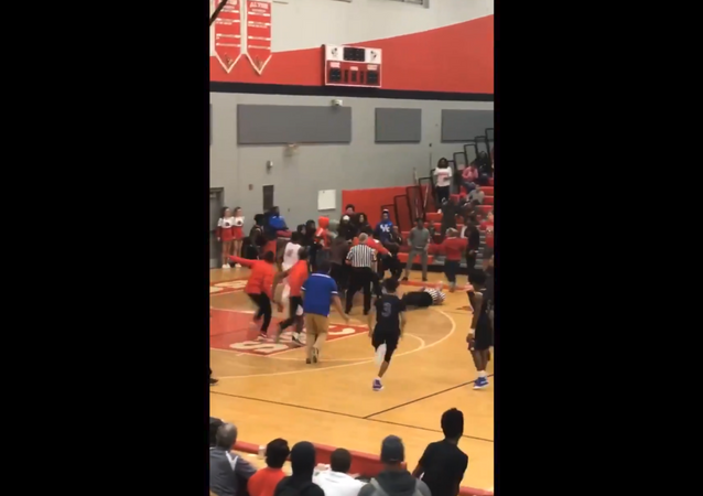Massive brawl breaks out at US high school basketball tournament, causing several school officials and local law enforcement personnel to jump in and squash the fracas