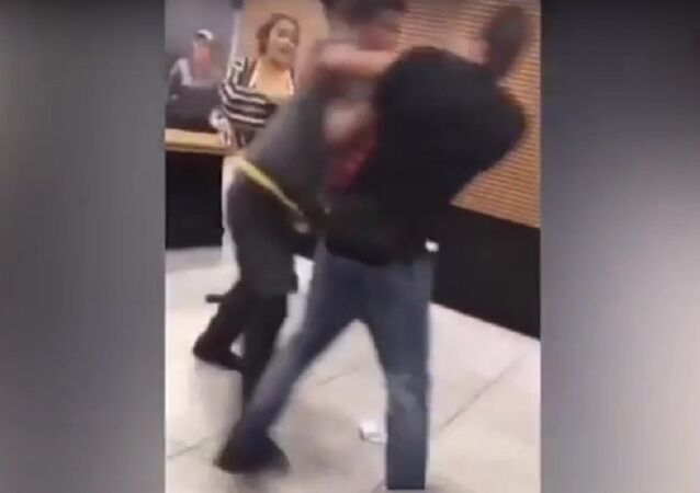 Angry McDonald's employee pushes customer to the ground
