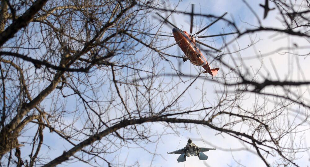 Mi-26 Helicopter Hauling Around 15-Tonne Su-27 Fighter