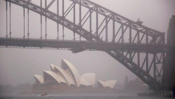 A boat passes under the Sydney Harbour Bridge and in front of the Sydney Opera House as strong winds and heavy rain hit the city of Sydney, Australia, November 28, 2018 - Sputnik International
