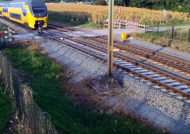 Look Both Ways! Dutch Cyclist Nearly Meets Demise by Double Decker Train