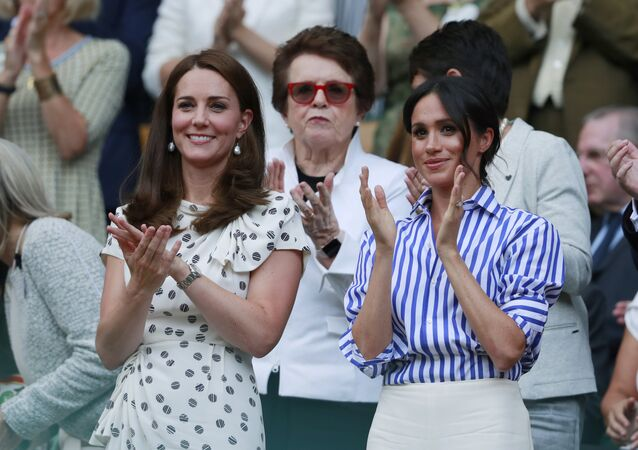 Kate, Duchess of Cambridge and Meghan, Duchess of Sussex, right, applaud during the women's singles final match between Serena Williams of the US and Angelique Kerber of Germany at the Wimbledon Tennis Championships, in London, Saturday July 14, 2018.