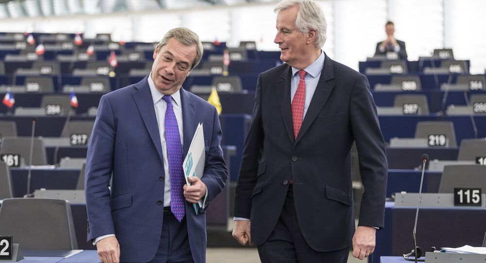 In this Wednesday, April 5, 2017 file photo Britain's former UKIP leader Nigel Farage, left, arrives with European Chief Negotiator of the Task Force for the Preparation and Conduct of the Negotiations with the United Kingdom under Article 50, Michel Barnier, before attending a session in Strasbourg, eastern France.