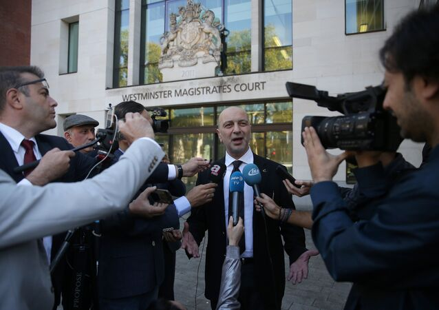 (FILES) In this file photo taken on September 25, 2018 Turkish businessman Akin Ipek speaks to members of the media as he leaves after appearing at Westminster Magistrates Court in London. A British court on November 28, 2018, rejected a request from Turkey to extradite Ipek, who is accused of helping to finance a 2016 coup attempt, his lawyers said
