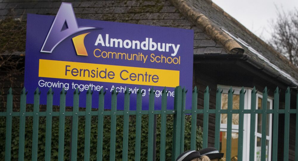 This Wednesday, Nov. 28, 2018 photo shows Police Community Support Officers walks outside Almondbury Community School in Huddersfield where a 16-year-old boy is to be charged with assault over an attack on a 15-year-old Syrian refugee.