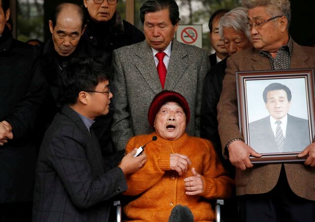 Kim Seong-ju, a victim of wartime forced labor during the Japanese colonial period, speaks after hearing the court ruling at the Supreme Court in Seoul, South Korea,