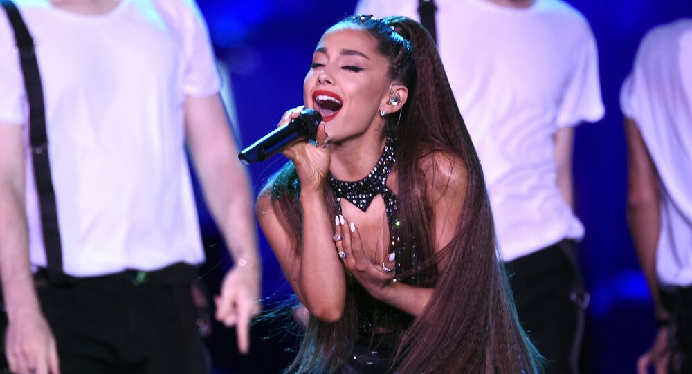 In this June 2, 2018 file photo, Ariana Grande performs at Wango Tango in Los Angeles. Grande will return with a new tour in 2019 nearly two years after a terrorist attack during her concert in the United Kingdom. Grande announced Friday, Oct. 26, that her 42-date Sweetener World Tour will kick off March 18 in Albany, N.Y.