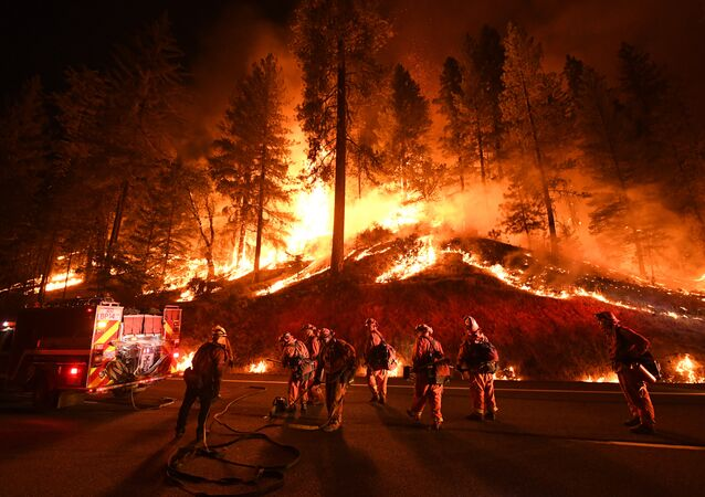 Firefighters try to control a back burn as the Carr fire continues to spread towards the towns of Douglas City and Lewiston near Redding, California on July 31, 2018