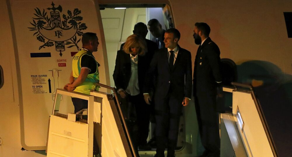 French President Emmanuel Macron and his wife Brigitte Macron arrive at Ministro Pistarini International Airport for the G20 leaders summit in Buenos Aires, Argentina November 28, 2018