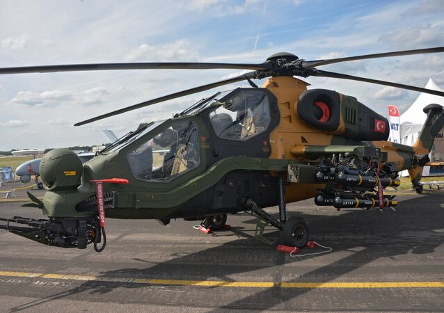 Turkish T129 ATAK chopper at an arms expo in 2014.
