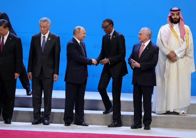 November 30, 2018. Russian President Vladimir Putin at a photo session of the heads of the G20 states, invited parties and international organizations. Right to left - Crown Prince of Saudi Arabia Mohammed bin Salman, President of Brazil Michel Temer and President of Rwanda Paul Kagame. From left to right: Chinese President Xi Jinping and Singapore's Prime Minister Li Xianlong.