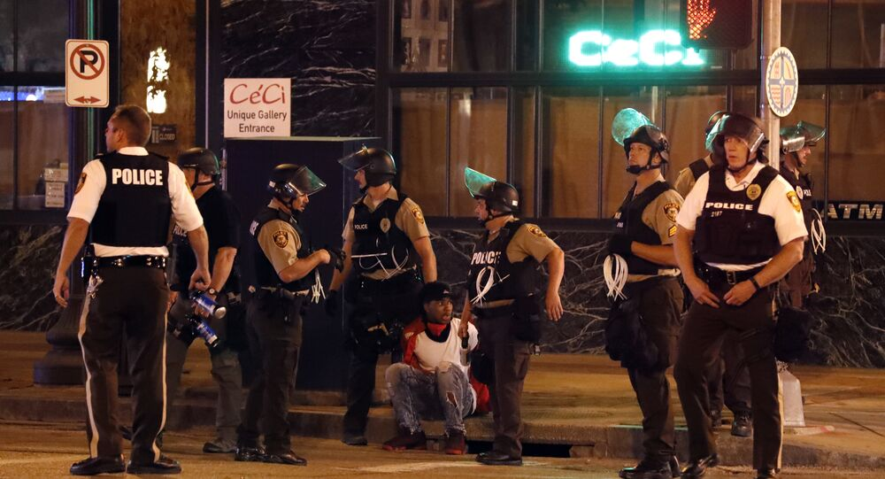 Police detain a man after a earlier peaceful protest in response to a not guilty verdict in the trial of former St. Louis police officer Jason Stockley turned violent Sunday, Sept. 17, 2017, in St. Louis.