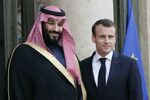 French President Emmanuel Macron, right, poses with Saudi Arabia Crown Prince Mohammed bin Salman before a meeting at the Elysee Palace in Paris, Tuesday, April 10, 2018.