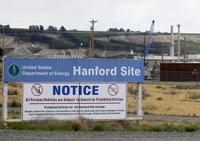 In this July 9, 2014, file photo, a sign informs visitors of prohibited items on the Hanford Nuclear Reservation near Richland, Wash