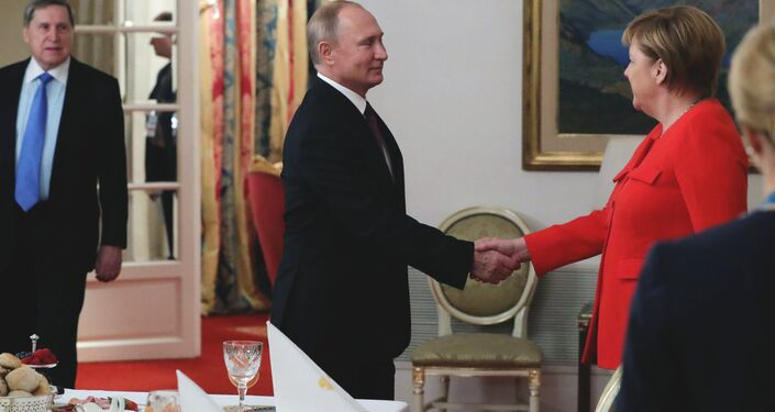Russian President Vladimir Putin and German Chancellor Angela Merkel meet on the sidelines of the G20 summit in Buenos Aires, Argentina. December 1, 2018