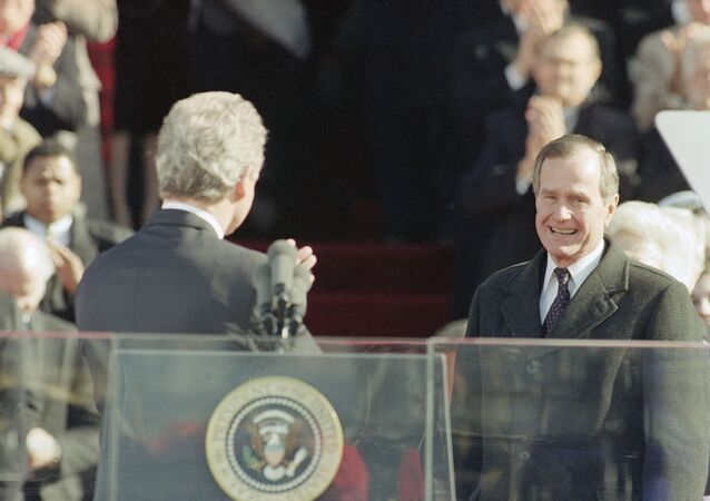 Pres. Bill Clinton, left, gestures toward former Pres. George H. W. Bush after giving his inaugural speech on Capitol Hill, Wednesday, Jan. 21, 1993, Washington, Washington, D.C