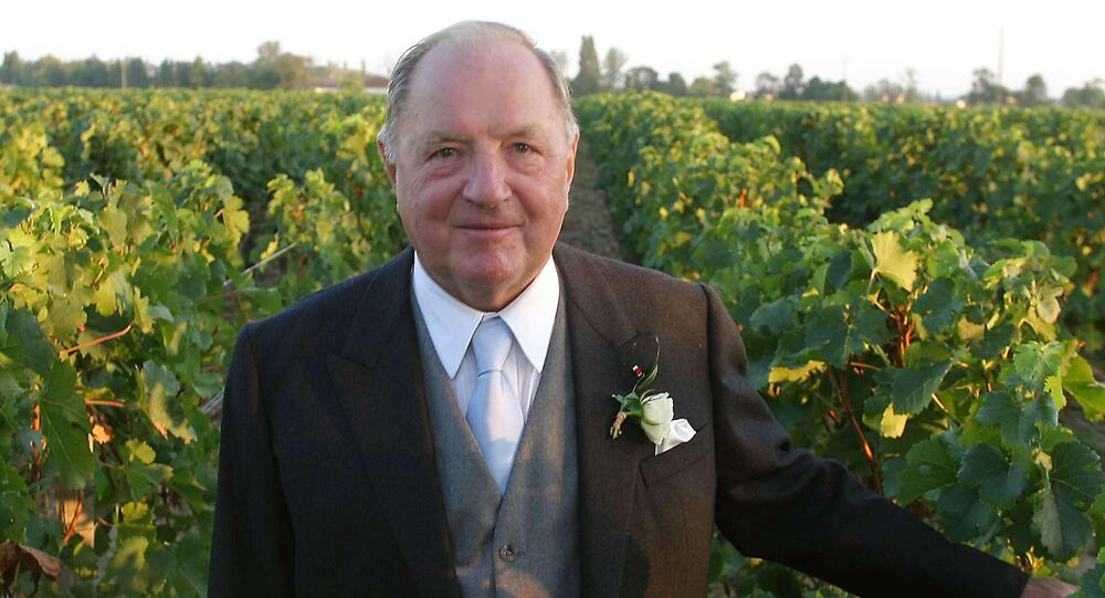 (FILES) In this file photo taken on September 06, 2003 Belgian businessman and billionaire Albert Frere, then 77, poses in his vineyard of the Château Cheval Blancin Saint-Emilion, at the wedding of his daughter Ségolène with the British financier Ian Gallienne
