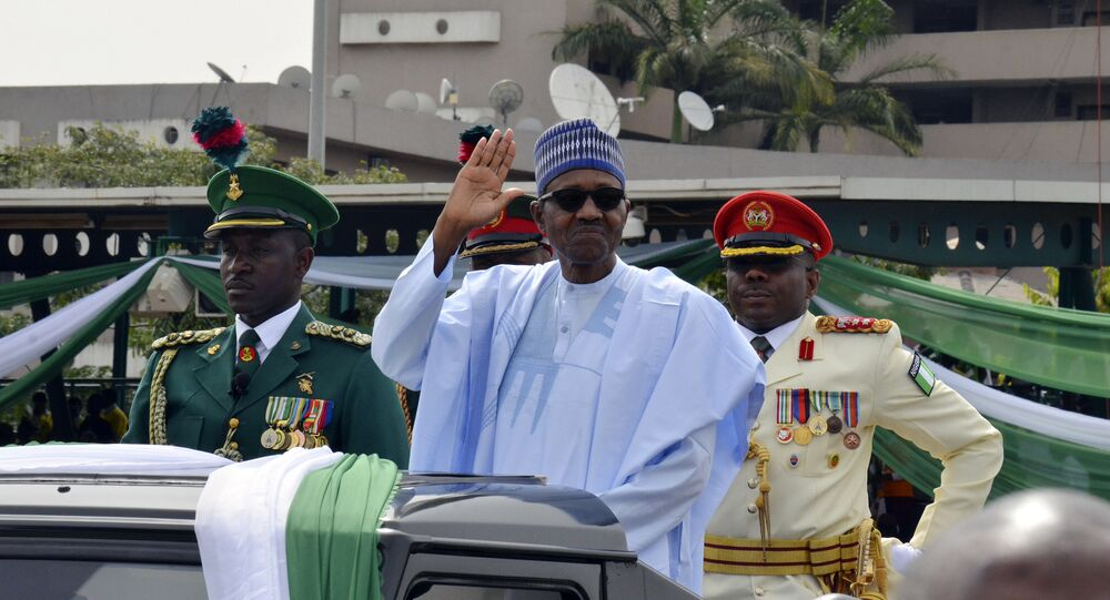 Nigerian President, Muhammadu Buhari, waves to the crowd during the 58th anniversary celebrations of Nigerian independence, in Abuja, Nigeria, Monday, Oct. 1, 2018