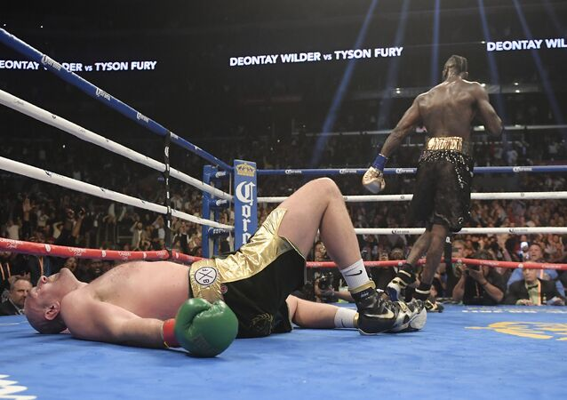Tyson Fury lies prostrate on the canvas in the final round of Saturday's fight with Deontay Wilder in Los Angeles