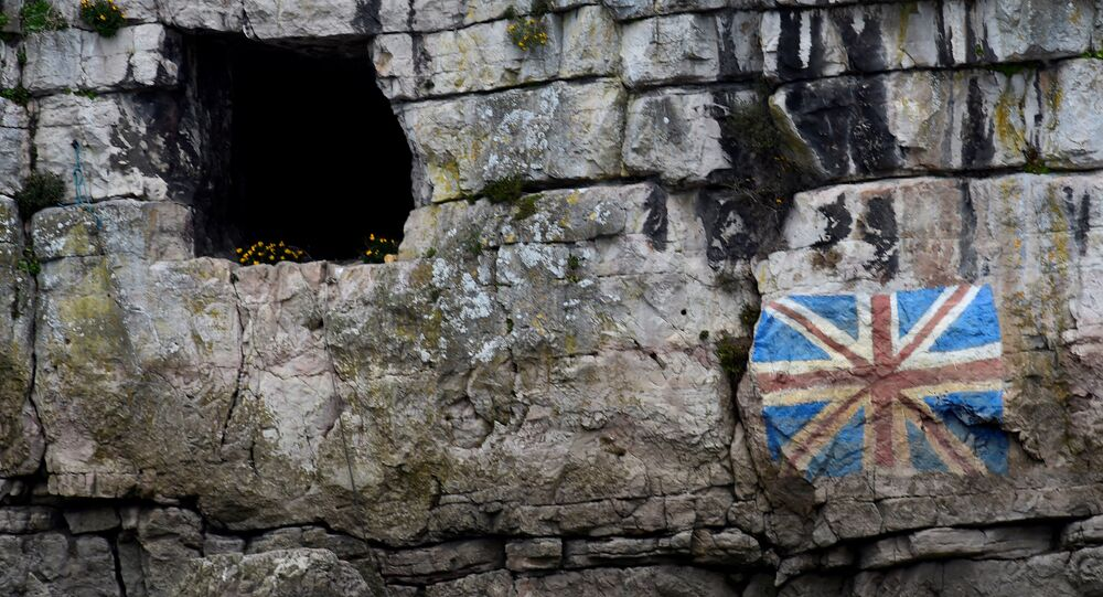 A painted Union Flag, popularly known as the Union Jack, the national flag of the United Kingdom is seen on the rocks on the English side of the River Wye, Chepstow, Wales