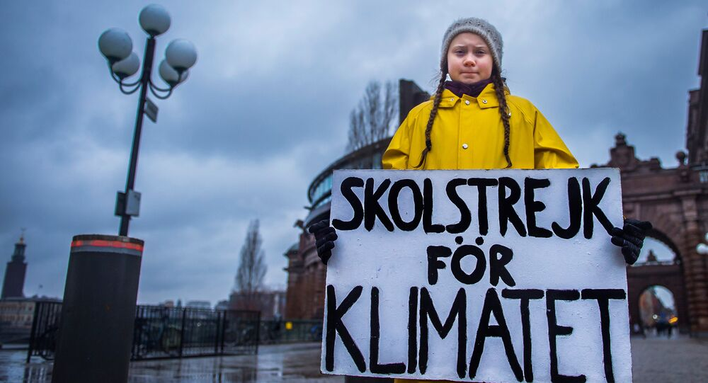 15-year-old Swedish girl Greta Thunberg holds a placard reading School strike for the climate during a manifestation against climate change outside the Swedish parliament in Stockholm, Sweden November 30, 2018
