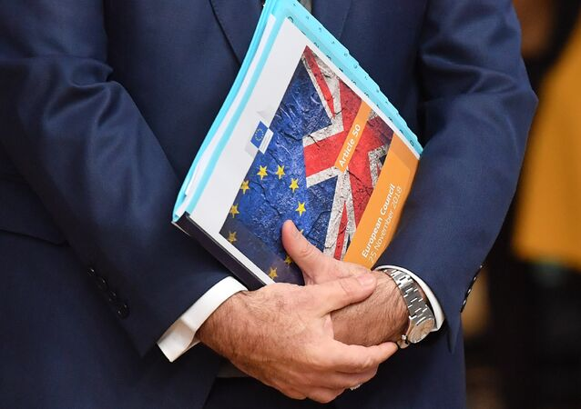 European Union flag and UK flag are seen on the front page of document reading article 50 - European Council before the special meeting of the European Council to endorse the draft Brexit withdrawal agreement and to approve the draft political declaration on future EU-UK relations on November 25, 2018 in Brussels
