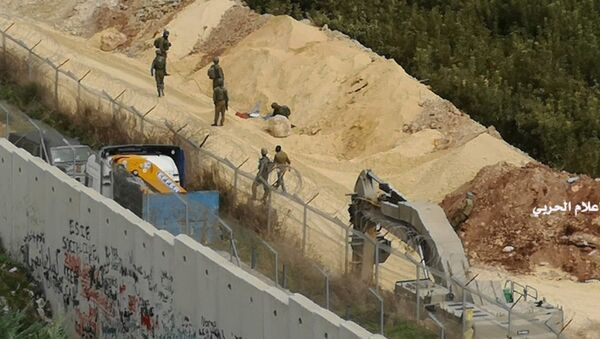 In this photo released by Hezbollah Central Military Media, Israeli military digger work on the Lebanese-Israeli border next to a wall that was built by Israel in the southern village of Kafr Kila, Lebanon on Tuesday, Dec. 4, 2018. - Sputnik International