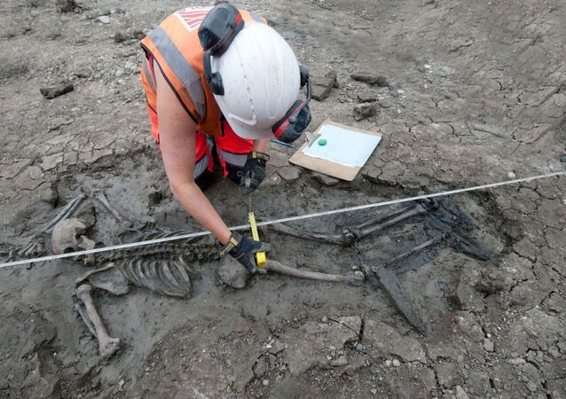 A 500-year-old skeleton was recently discovered by archaeologists in the mud under London's River Thames wearing intact thigh-high leather footwear