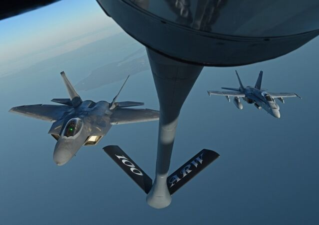 A U.S. Air Force F-22 Raptor and a Finnish air force F/A-18 Hornet fly behind a U.S. Air Force KC-135 Stratotanker during training off the coast of Finland, Oct 19, 2018. The Raptors deployed from the 27th Fighter Squadron, Joint Base Langley-Eustis, Virginia, and arrived in Europe Oct. 5. The F-22s trained with different NATO allies and partners to deter potential threats and increase regional security.