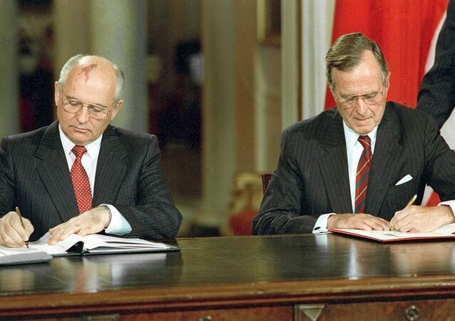 Soviet President Mikhail Gorbachev, left, and U.S. President George Bush signing bilateral documents during Gorbachev's official visit to the United States