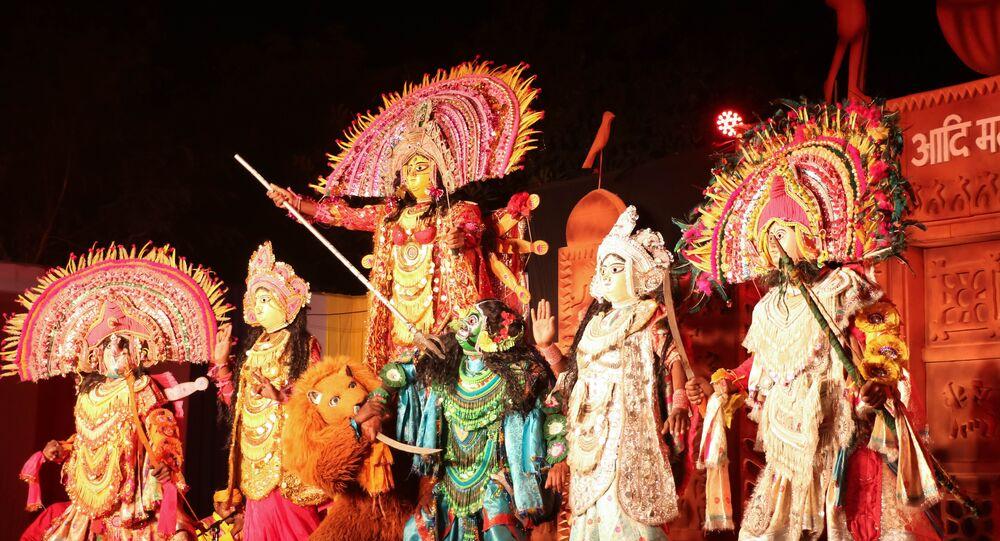 Story of Hindu Goddess Durga killing the demon depicting victory of good over evil on display at Delhi Haat