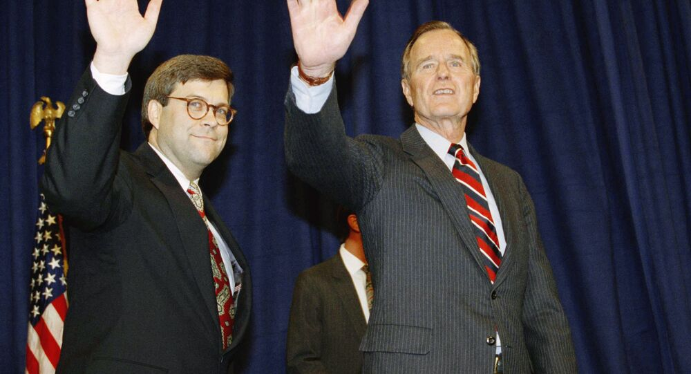U.S. President George H. Bush, right, and William Barr wave after Barr was sworn in as the new Attorney General of the United States, Tuesday, Nov. 26, 1991 at a Justice Department ceremony in Washington.