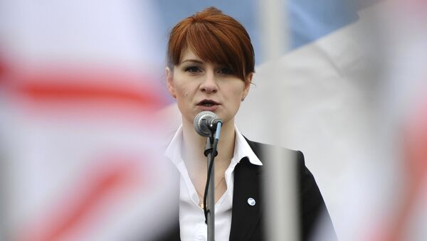 In this photo taken on Sunday, April 21, 2013, Maria Butina, leader of a pro-gun organization in Russia, speaks to a crowd during a rally in support of legalizing the possession of handguns in Moscow, Russia - Sputnik International