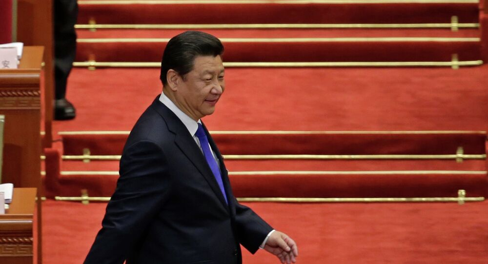 Chinese President Xi Jinping arrives for the opening of the annual full session of the National People's Congress