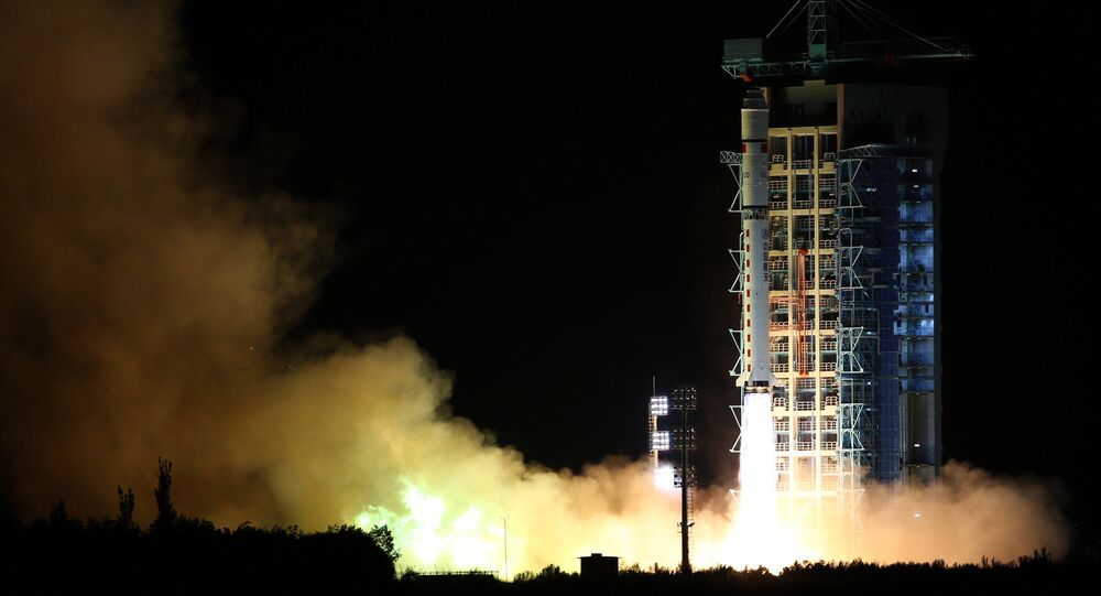 In this photo released by China's Xinhua News Agency, a Long March-2D rocket carrying the world's first quantum satellite lifts off from the Jiuquan Satellite Launch Center in Jiuquan, northwestern China's Gansu Province, early Tuesday, Aug. 16, 2016