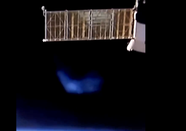 A mysterious blue orb appears on the International Space Station's live feed