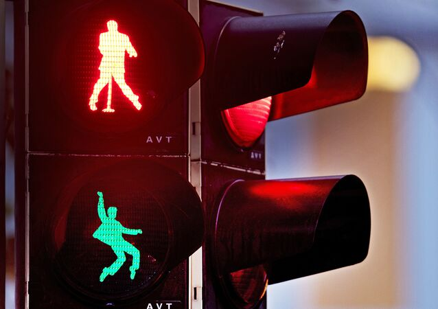 Walking figures depicting late US rock and roll legend Elvis Presley appear on a traffic light switching from green to red in Friedberg near Frankfurt, Germany, Thursday, Dec. 6, 2018