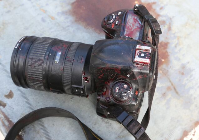 ATTENTION EDITORS - VISUALS COVERAGE OF SCENES OF DEATH OR INJURY - The blood stained camera of a photojournalist is seen after a secondary explosion in front of Dayah hotel in Somalia's capital Mogadishu