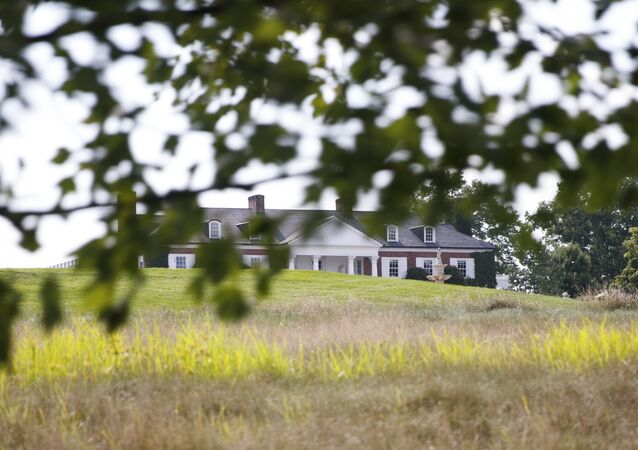 The clubhouse of Trump National Golf Club is seen from the media van, Thursday, Aug. 9, 2018, Bedminster, N.J., before a President Donald Trump meets with state leaders about prison reform.(AP Photo/Carolyn Kaster)