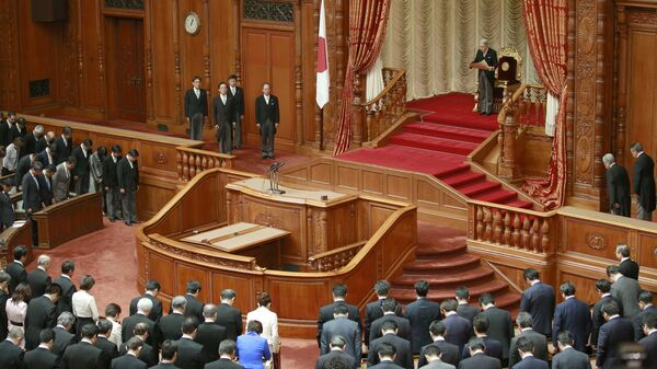 Japan's Emperor Akihito, top, reads a statement to formally open a Diet session at the upper house of parliament in Tokyo, 2016 - Sputnik International