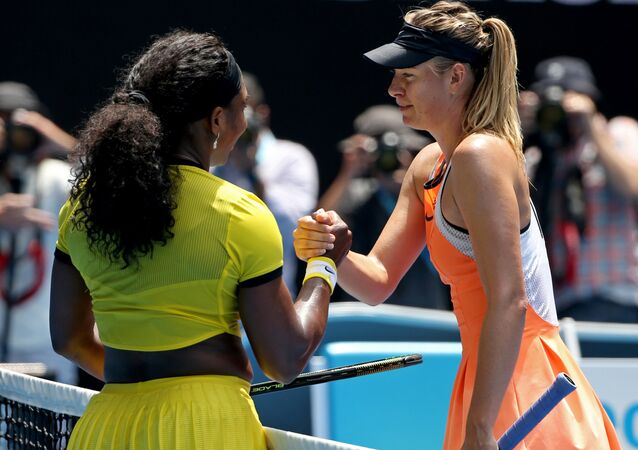 Serena Williams, left, of the United States is congratulated by Maria Sharapova of Russia after winning their quarterfinal match at the Australian Open tennis championships in Melbourne, Australia, Tuesday, Jan. 26, 2016