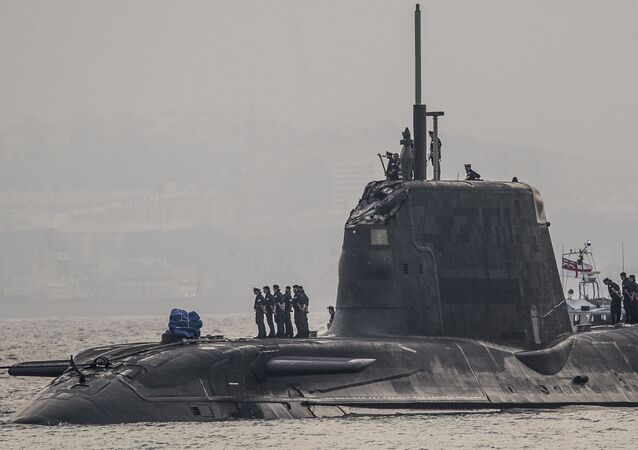 In this Wednesday July 20, 2016, British Royal Navy submarine HMS Ambush's arrives into the Naval Base at Gibraltar. A British Royal Navy submarine has been forced into port after colliding with a merchant vessel off the coast of Gibraltar