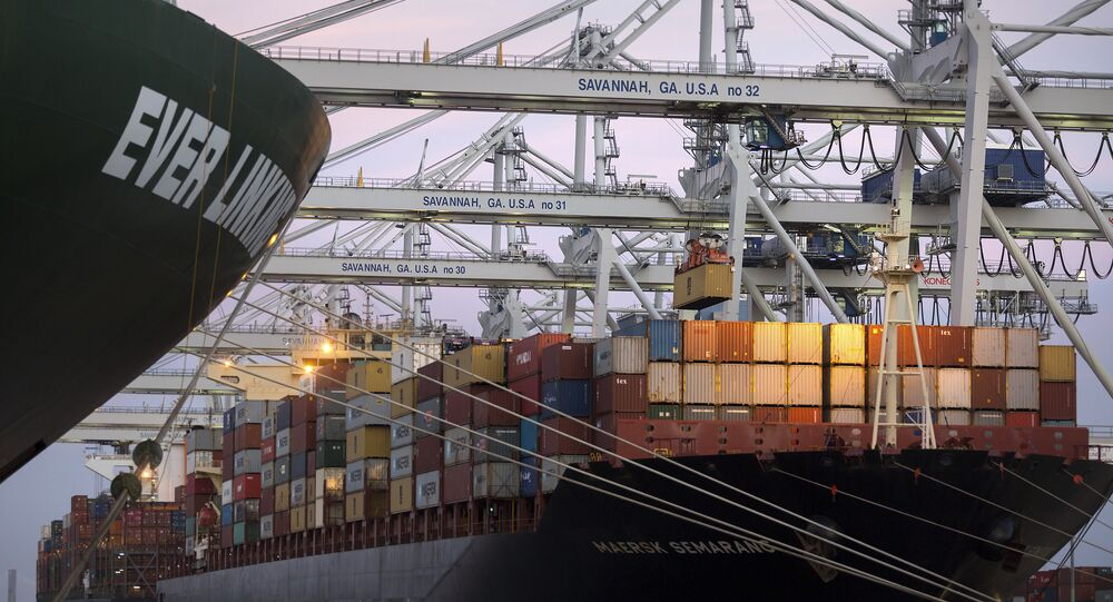 ship to shore cranes stack shipping containers on-board the container ship Maersk Semarang, Tuesday, June 19, 2018, at the Port of Savannah in Savannah, Ga