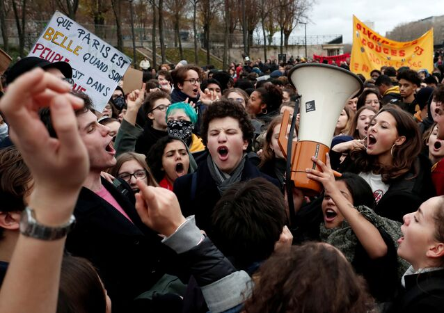 Youths and high school students attend a demonstration to protest against the French government's reform plan, in Paris, France, December 7, 2018