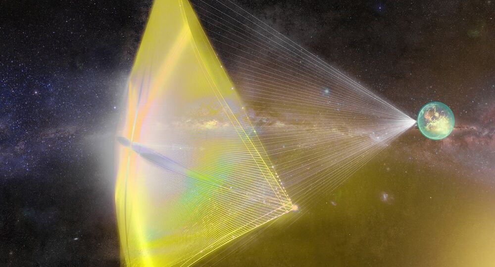 An illustration of a Breakthrough Starshot 'nanocraft' being propelled toward the Alpha Centauri star system with a powerful laser beam