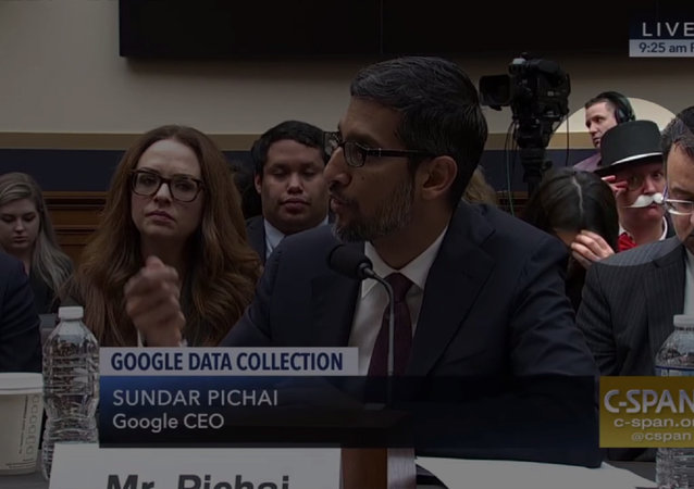 Protester Ian Madrigal dresses as the Monopoly Man during Google CEO Sundar Pichai's testimony before the House Judiciary Committee.