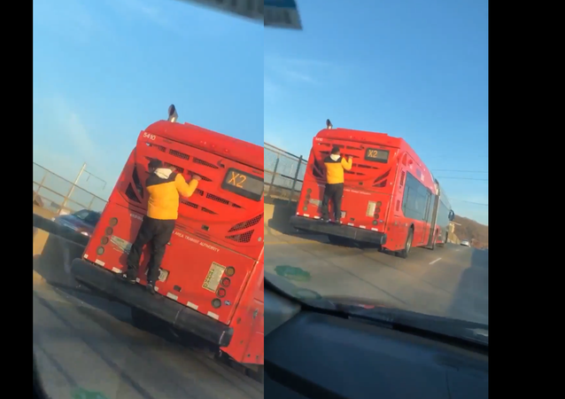 'Only in DC': Teen Spotted Clinging to Bus Chugging Through US Capital