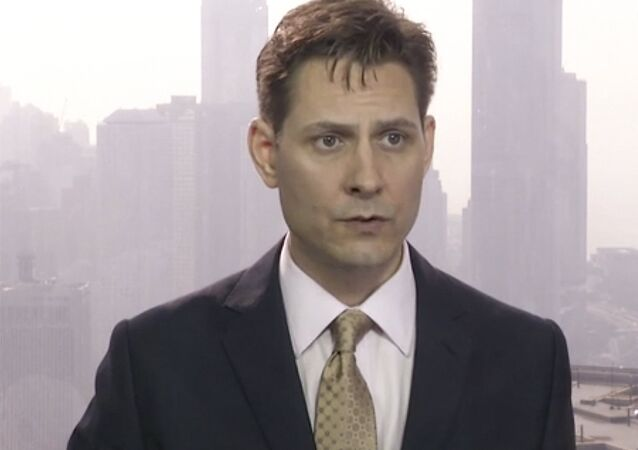In this image made from a video taken on March 28, 2018, Michael Kovrig, an adviser with the International Crisis Group, a Brussels-based non-governmental organization, speaks during an interview in Hong Kong. Canadian Public Safety Minister Ralph Goodale confirmed on Tuesday, Dec. 11, 2018, that Kovrig, a former Canadian diplomat, was arrested Monday night in Beijing, China