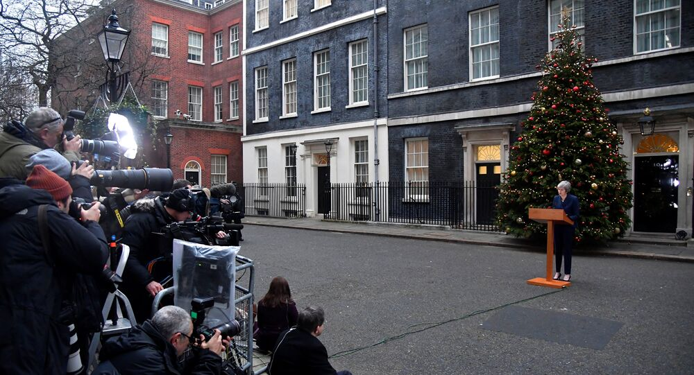 Britain's Prime Minister Theresa May addresses the media outside 10 Downing Street after it was announced that the Conservative Party will hold a vote of no confidence in her leadership, in London, Britain, December 12, 2018